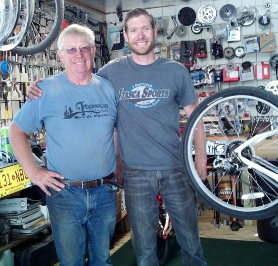 Sam and his dad at the bike shop at Itasca State Park