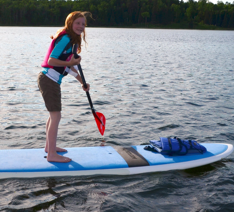 Stand-up paddleboarding at Itasca State Park