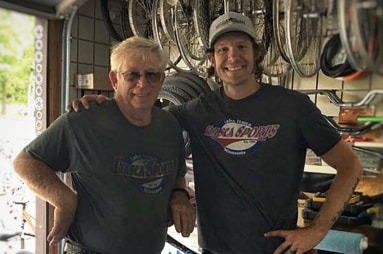 Sam Smith and his dad in the bike repair shop at Itasca Sports